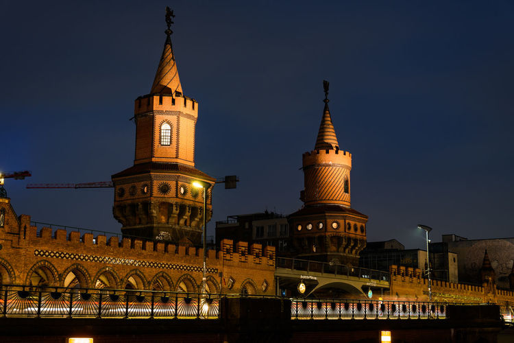"""Bridge """"Oberbaum"""" and Spree in Berlin, Germany at night Oberbaumbrücke Oberbaumbridge Berlin Germany Architecture Built Structure Building Exterior Building Sky Travel Destinations Illuminated City No People Nature Tourism Travel Outdoors Spire  Spree Spree River Oberbaum Bridge Tower Low Angle View The Past History Belief Religion Clock"""