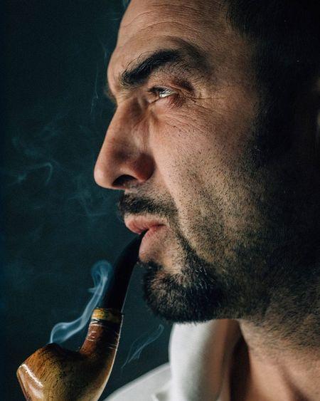 Close-Up Of Mature Man Smoking Cigarette