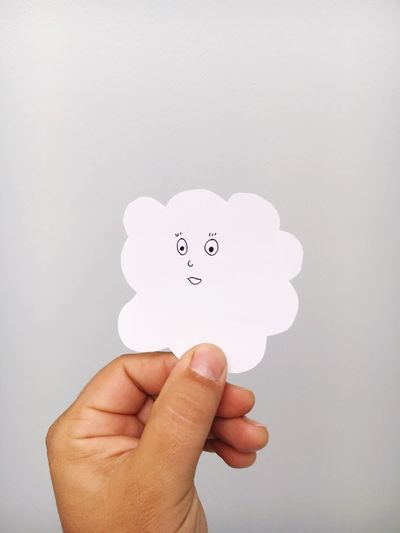 Cloud Clouds Cloudscape Clouds And Sky Cloud_collection  Human Hand Human Body Part Holding Copy Space White Background Studio Shot One Person Communication Close-up Indoors  Day People Cut Paper Copy Space Paper View Creativity Creative Draw Drawing