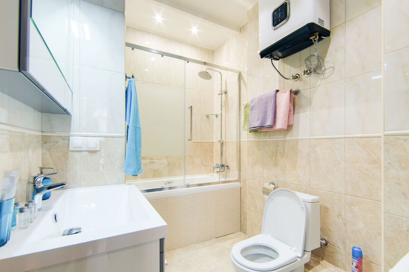 Bathroom Domestic Bathroom Sink Hygiene Mirror Indoors  Domestic Room Household Equipment Home Toilet Faucet Tile No People Flooring Towel Shower White Color Home Interior Absence Hanging Tiled Floor Clean