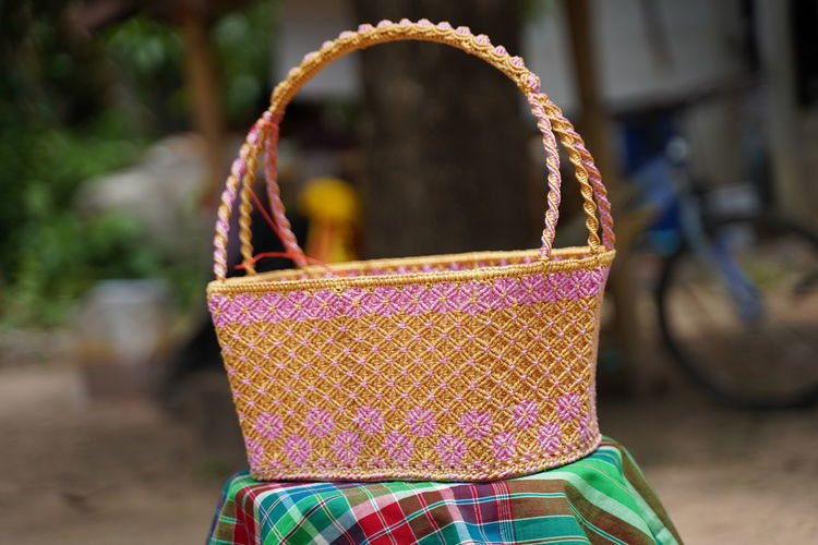 Close-up of wicker basket hanging on rope