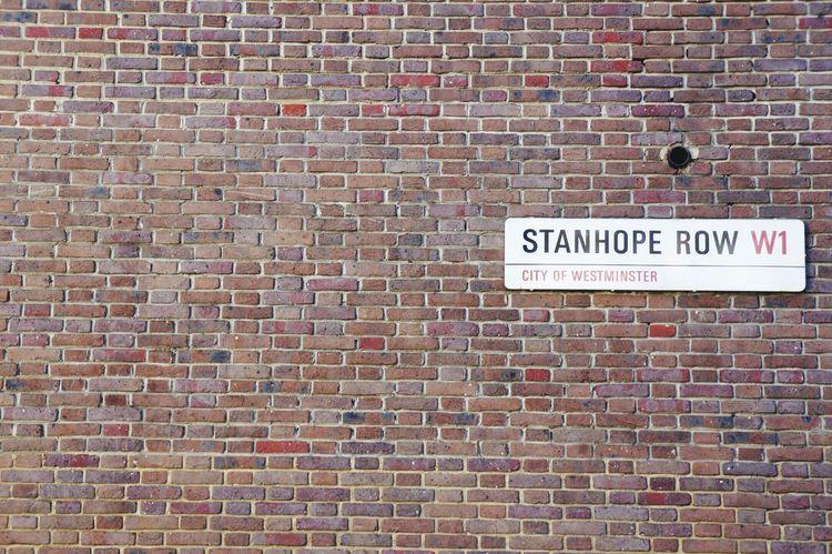 Sign brick Mayfair, London urban