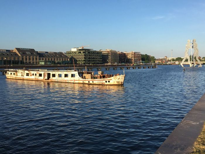 The river Spree once dividing east and West Berlin. Spree Berlin Water Architecture Built Structure Building Exterior Sky City Transportation Water Architecture Built Structure Building Exterior Sky City Transportation