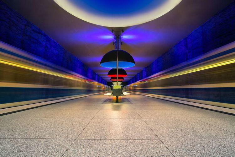 Illuminated railroad station platform