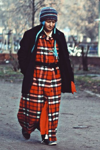 Portrait of woman standing in park during winter