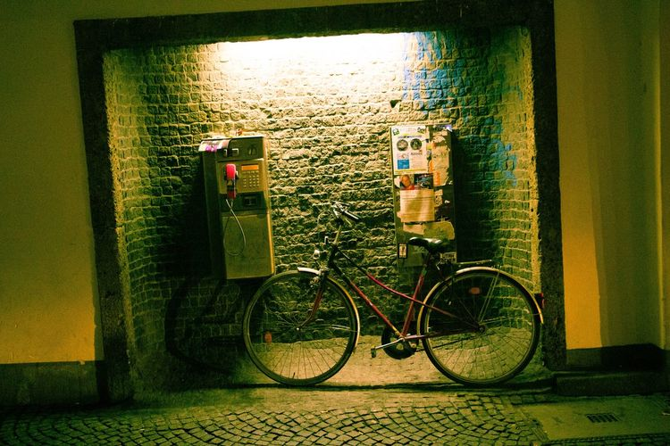 Bicycle on wall against building