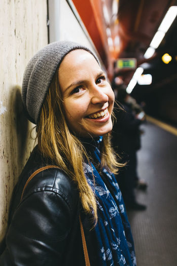 Casual Clothing Close-up Confidence  Europe European  Focus On Foreground Front View Girl Happy Headshot Jacket Lady Leisure Activity Lifestyles Long Hair Metro Portrait Smile Subway Toothy Smile Woman