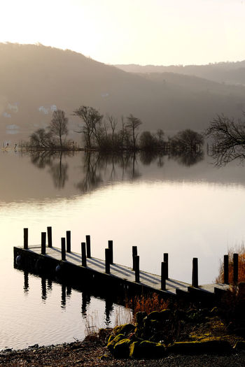 Lake District National Park Bare Tree Beauty In Nature Cold Temperature Day Fog Jetty Jetty Structure Jetty View Lake Landscape Mountain Nature No People Outdoors Reflection Scenics Sky Tranquil Scene Tranquility Tree Water Wooden Post