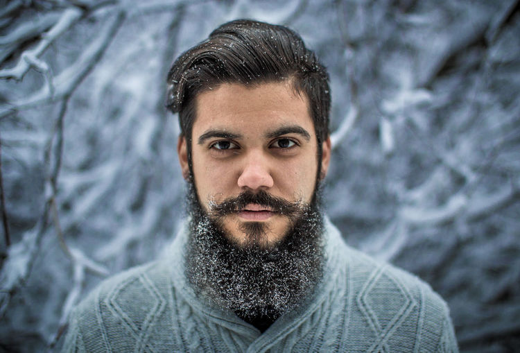 Portrait of young bearded man during winter