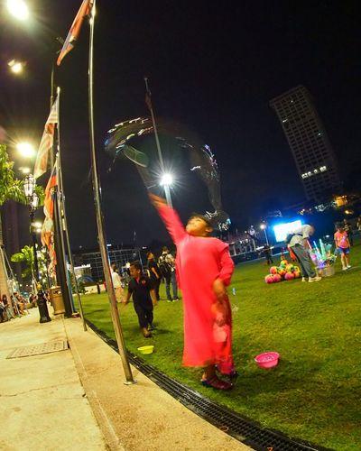 Rear view of people enjoying at night