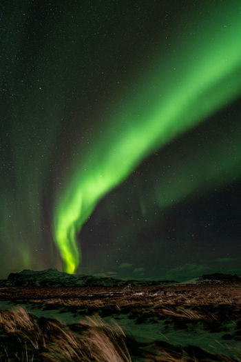 Night Beauty In Nature Scenics - Nature Sky Green Color Star - Space Astronomy Space Tranquil Scene Tranquility Idyllic Nature No People Aurora Polaris Water Star Non-urban Scene Low Angle View Environment Star Field Iceland