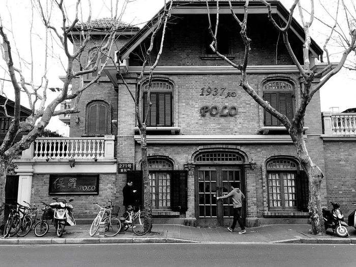Architecture Building Exterior Built Structure City Outdoors Day People City Real People Urban Landscape Branch Bare Tree Tree Brick Wall The City Light IPhoneography Light And Shadow Old Architecture Old Buildings Urban Lifestyle Architecture Bicycle Black And White Black & White
