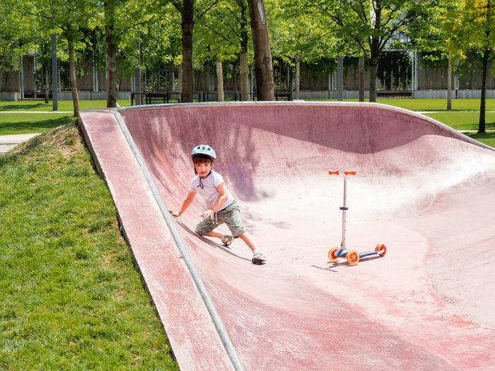 Boy skateboarding on skateboard park