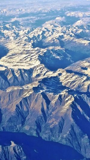 Aerial View Airplaneview Alps Beauty In Nature Blue High Angle View Landscape Mountain Mountain Range Nature Outdoors Scenics Snow Snowcapped Mountain Sunlight Tranquil Scene Tranquility EyeEmNewHere Live For The Story BYOPaper! Your Ticket To Europe The Week On EyeEm Lost In The Landscape Connected By Travel Go Higher Inner Power The Great Outdoors - 2018 EyeEm Awards The Traveler - 2018 EyeEm Awards The Creative - 2018 EyeEm Awards