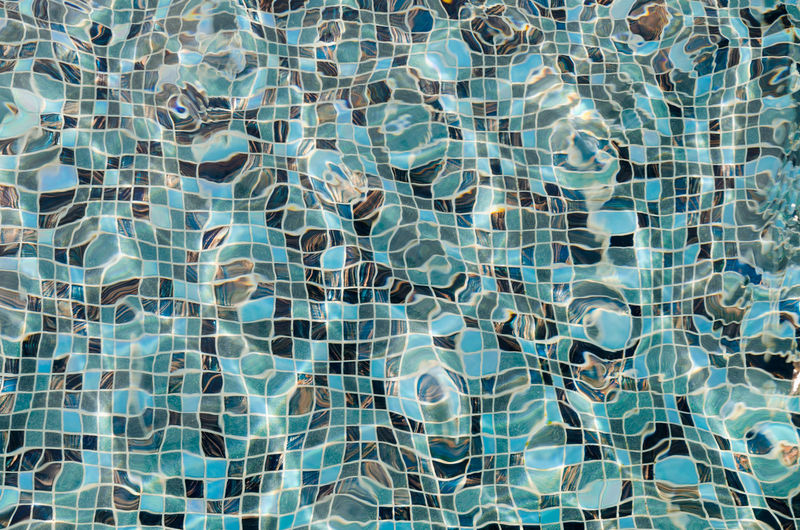 Sunlight Backgrounds Blue Day Flooringpattern Full Frame High Angle View Luxury No People Outdoor Pattern Pool Reflection Rippled Swimming Pool Tile Tiled Floor Transparent Water Turquoise Colored Water