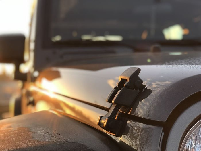 Close-up of car during sunset
