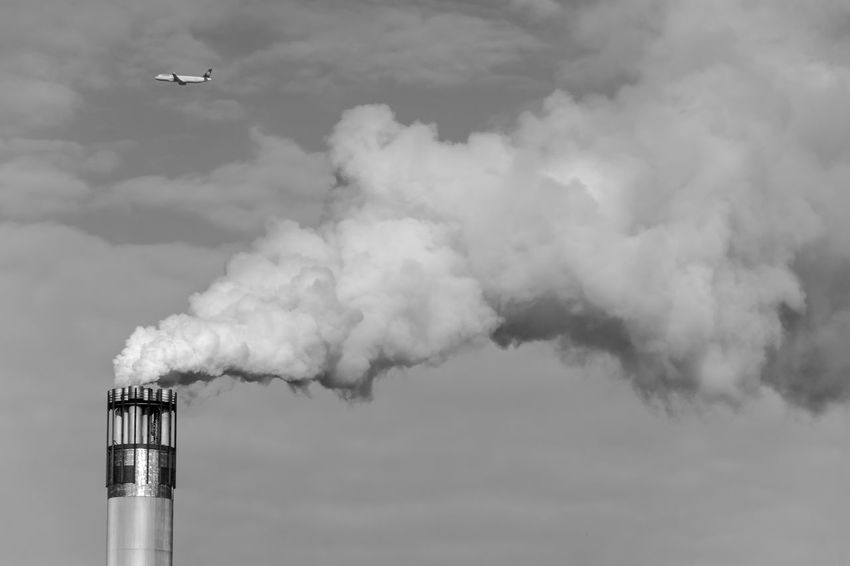 Abgase Aeroplane Aerospace Industry Air Pollution Architecture Urban Exploration Built Structure Cooling Tower Day Emitting Factory Flying Fumes Industry Monochrome Monochrome Photography No People Outdoors Plane Rauch Sky Smoke Smoke - Physical Structure Smoke Stack Urban Collection