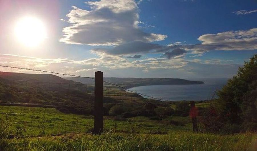 Tranquil Scene Scenics Tranquility Sky Grass Protection Sun Sea Beauty In Nature Safety Cloud - Sky Sunbeam Seaside Seaview From Above  Coastal View Hill Drone  Phantom Waves Beach Fence Sunset Coast Robinhoods Bay