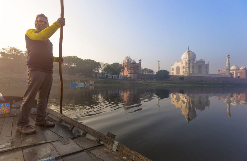 View of Taj Mahal from the boat in Yamuna River Love Taj Mahal Yamuna Architecture Building Exterior Built Structure Day Full Length Leisure Activity One Person Outdoors Real People Reflection Sky Standing Tourism Travel Travel Destinations Water World Wonder