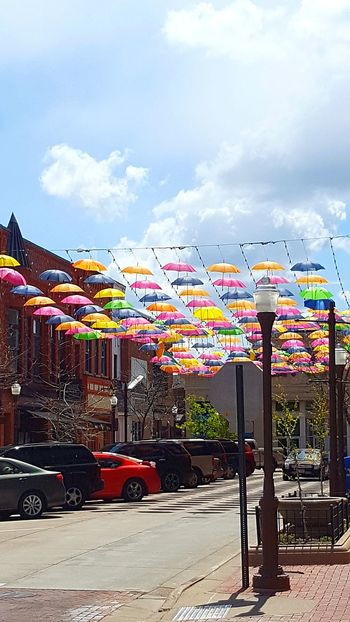 Sping Umbrellas - Downtown Wausau, Wisconsin Event City Street Colorful Umbrellas Annual Event Decorative Art Hanging Spring Festival Downtown Wausau Wisconsin