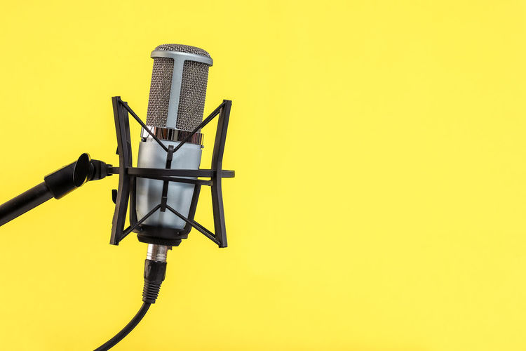 Microphone on Yellow background Yellow Copy Space No People Technology Studio Shot Close-up Metal Photography Themes Colored Background Indoors  Still Life Connection Communication Yellow Background Wall - Building Feature Single Object Arts Culture And Entertainment Tripod Cable