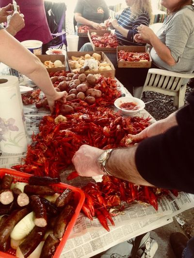 Crawfish boil get together Crawfish Boil  Cajun Food And Drink Food Freshness Real People Group Of People Human Hand Hand Lifestyles For Sale People Human Body Part Red Indoors  Women Choice Retail  Leisure Activity High Angle View Variation Adult First Eyeem Photo