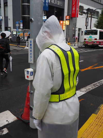 Architecture Day Hardhat  Headwear Helmet Lifestyles Men Occupation Occupational Safety And Health One Person Outdoors People Protective Workwear Real People Rear View Reflective Clothing Safety Standing Street Tokyo Uniform