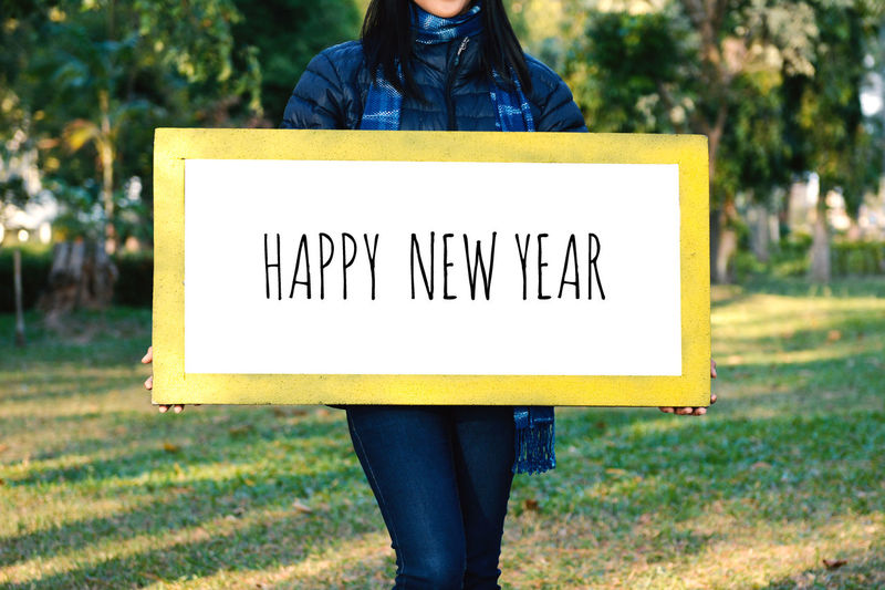 Woman Holding Happy New Year Message