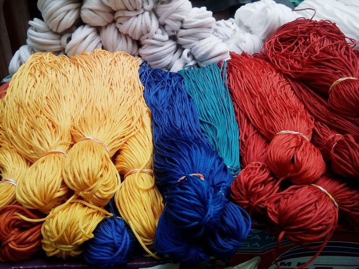 High angle view of wooden yarn for sale in shop