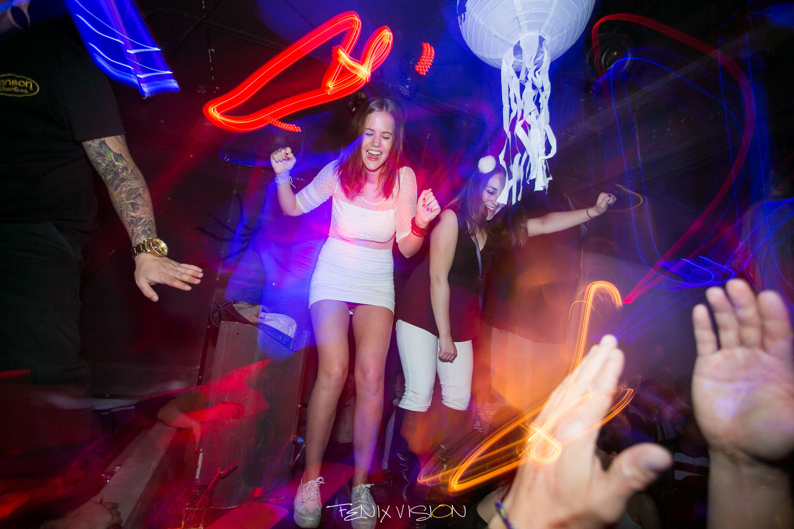 lifestyles, arts culture and entertainment, leisure activity, illuminated, enjoyment, fun, night, men, music, performance, skill, youth culture, nightlife, event, person, indoors, playing, arms raised