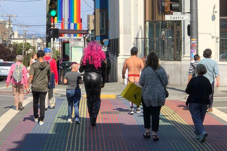 Rear view of people walking in city