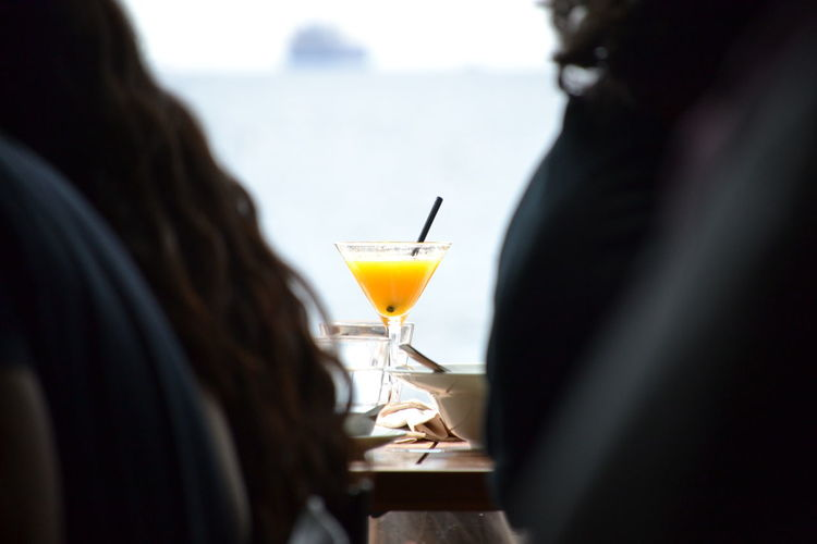 Rear view of a drink on table