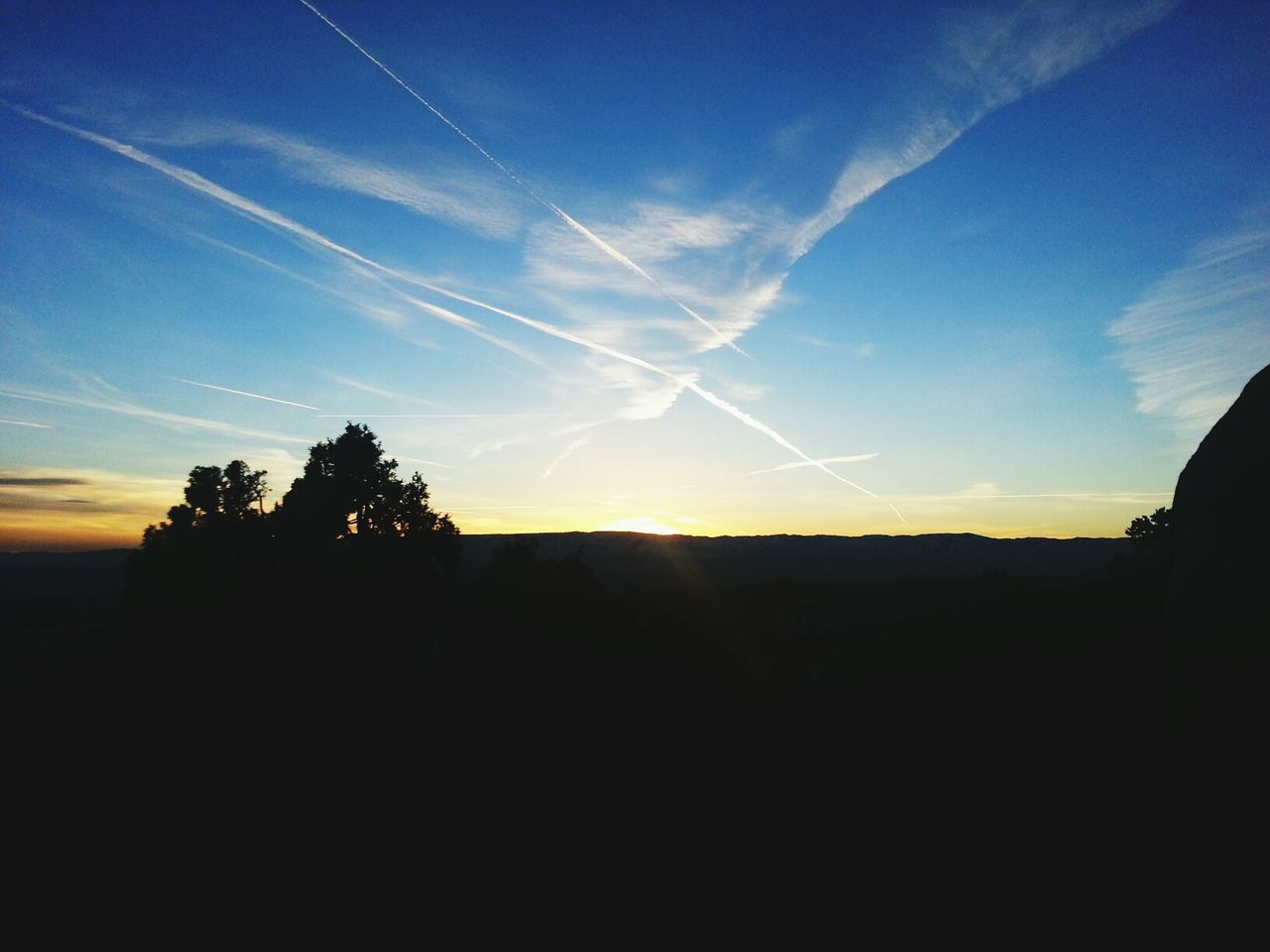 silhouette, sunset, landscape, sky, nature, no people, beauty in nature, tree, outdoors, vapor trail