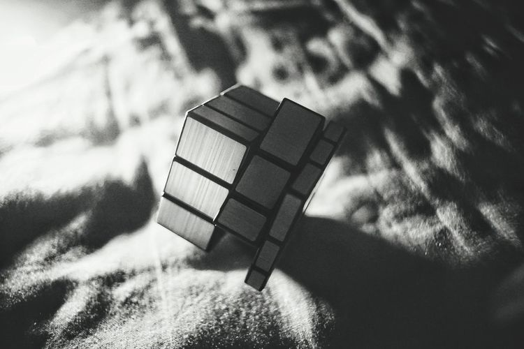 Close-up of puzzle cube on textile