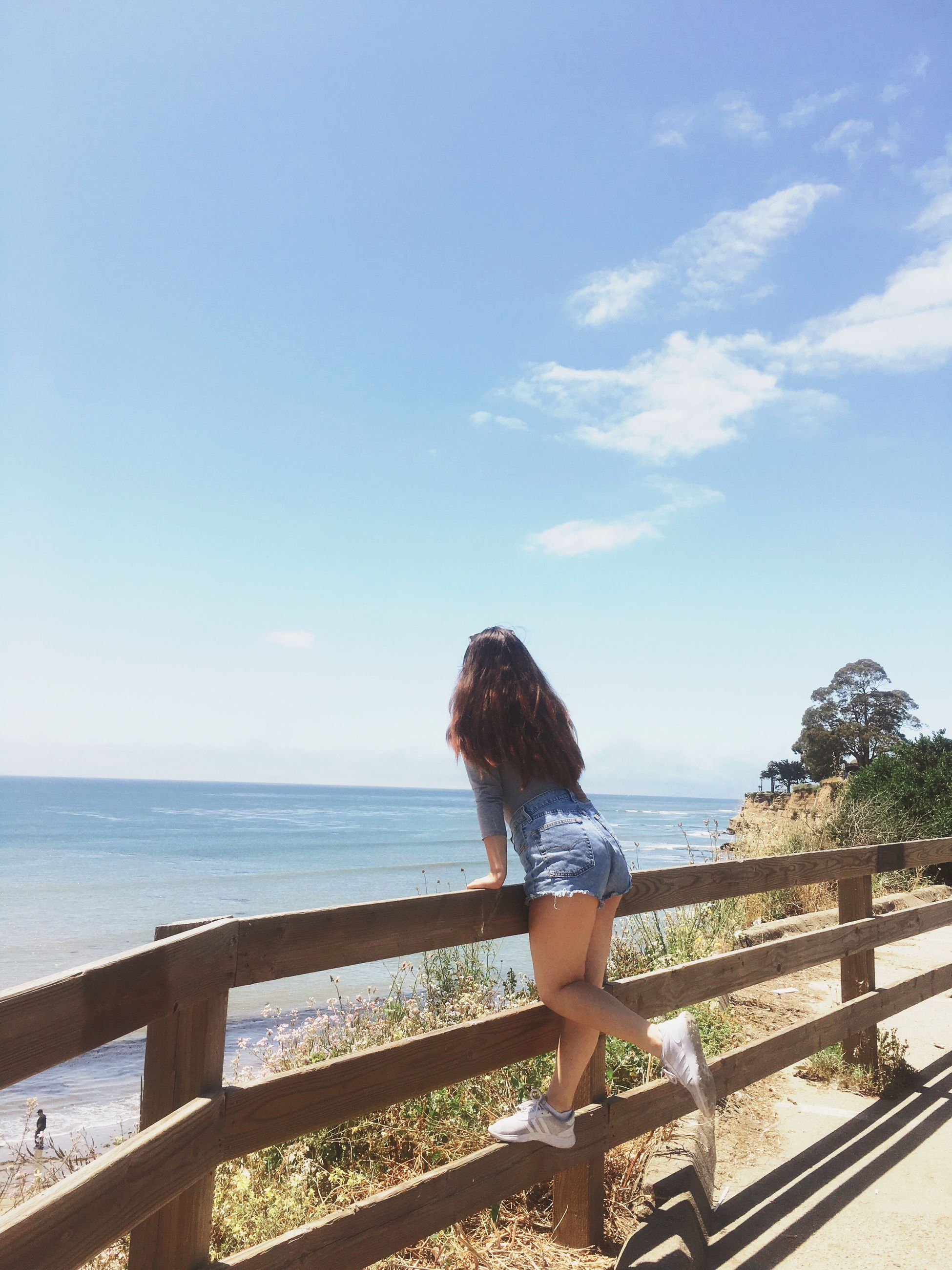 railing, sea, water, one person, real people, horizon over water, sky, nature, scenics, day, leisure activity, beauty in nature, lifestyles, outdoors, young adult, young women, full length, standing, people