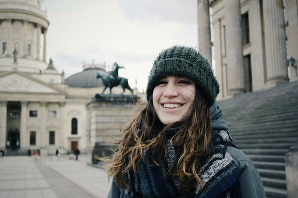One Woman Only Adults Only City Young Women Only Women Young Adult Long Hair Knit Hat One Young Woman Only People Smiling One Person Architecture Travel Destinations Adult Portrait Outdoors Warm Clothing Day EyeEm Diversity The Portraitist - 2017 EyeEm Awards