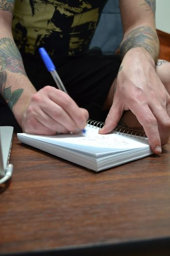Nikon Making A List Taking Notes Pen And Paper Tattoos Writing Tattooed Men Canadian Photographer