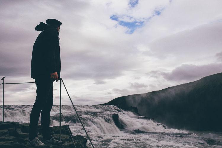 Male tourist looking at gullfoss fall