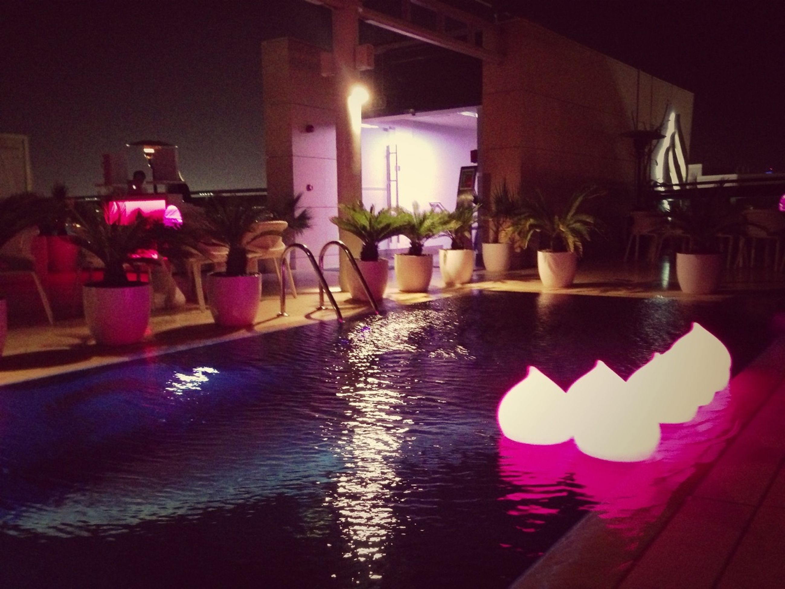 illuminated, night, architecture, built structure, lighting equipment, reflection, building exterior, decoration, multi colored, indoors, light - natural phenomenon, water, no people, glowing, house, table, celebration, potted plant, light, lantern
