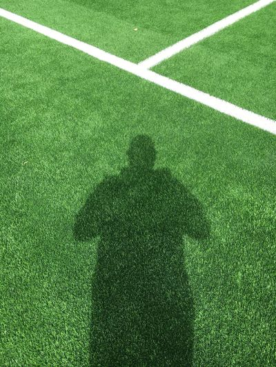 Shadow of man on soccer field