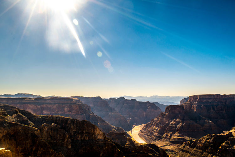 Grand Canyon Route 66 Beauty In Nature Bright Environment Landscape Lens Flare Mountain Mountain Peak Mountain Range Nature No People Non-urban Scene Outdoors Rock Rock - Object Scenics - Nature Sky Solar Flare Solid Sun Sunbeam Sunlight Tranquil Scene Tranquility Travel Destinations