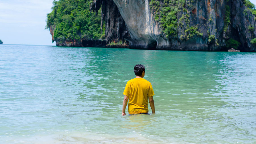 Calm Sea Standing Water Tranquil Scene Vacations Water Waterfront Yello Man In The Seaside Yellow Shirt
