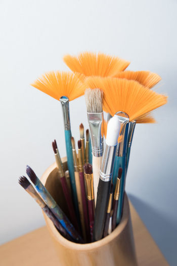 Brushes Still Life Brush Indoors  Studio Shot Art And Craft Choice Close-up Variation No People Large Group Of Objects Paintbrush Multi Colored White Background Collection Craft Creativity High Angle View Focus On Foreground Table Group Of Objects Art And Craft Equipment