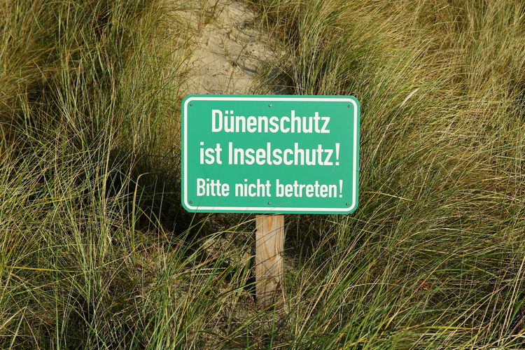 Close-up of warning sign on field