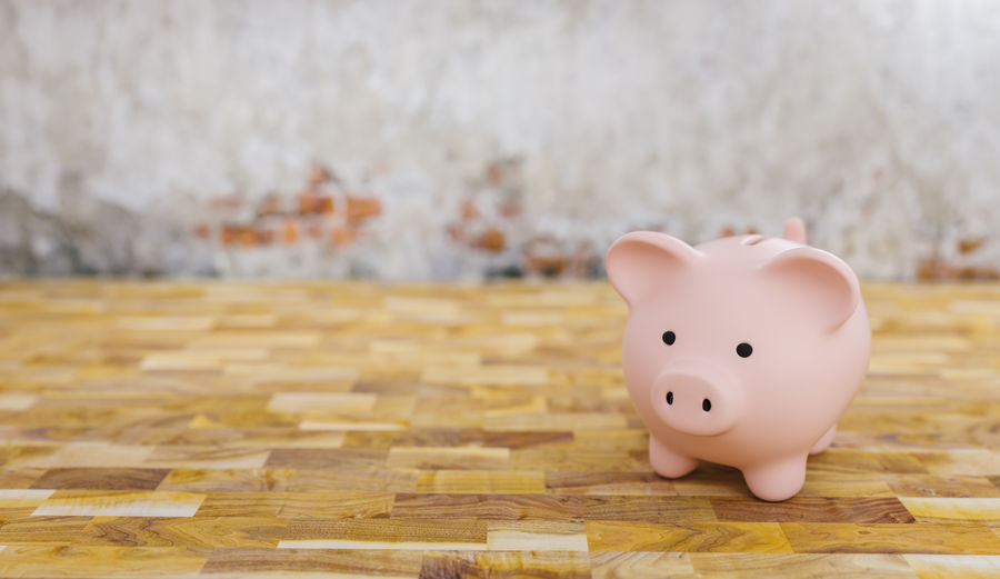 Piggy bank in a room with brick wall, copyspace for your individual text. Wood - Material Wood Wealth Toy Table Still Life Single Security Secure Savings Save Safe Row Room Rich Representation Rate Profit Planning Pink Piggybank Piggy Bank Piggy Pig Parquet Overweight Money Making Money Luxury Investment Invest Indoors  Individuality Idea House Building Growth Growing Fund Focus On Foreground Floor Financial Finance Economic Divorce Deposit Currency Copy Space Construction Concept Coin Bank Coin Close-up Childhood Cash Care Business Brick Wall Bigger Banking Bank Account Bank Animal Representation Account
