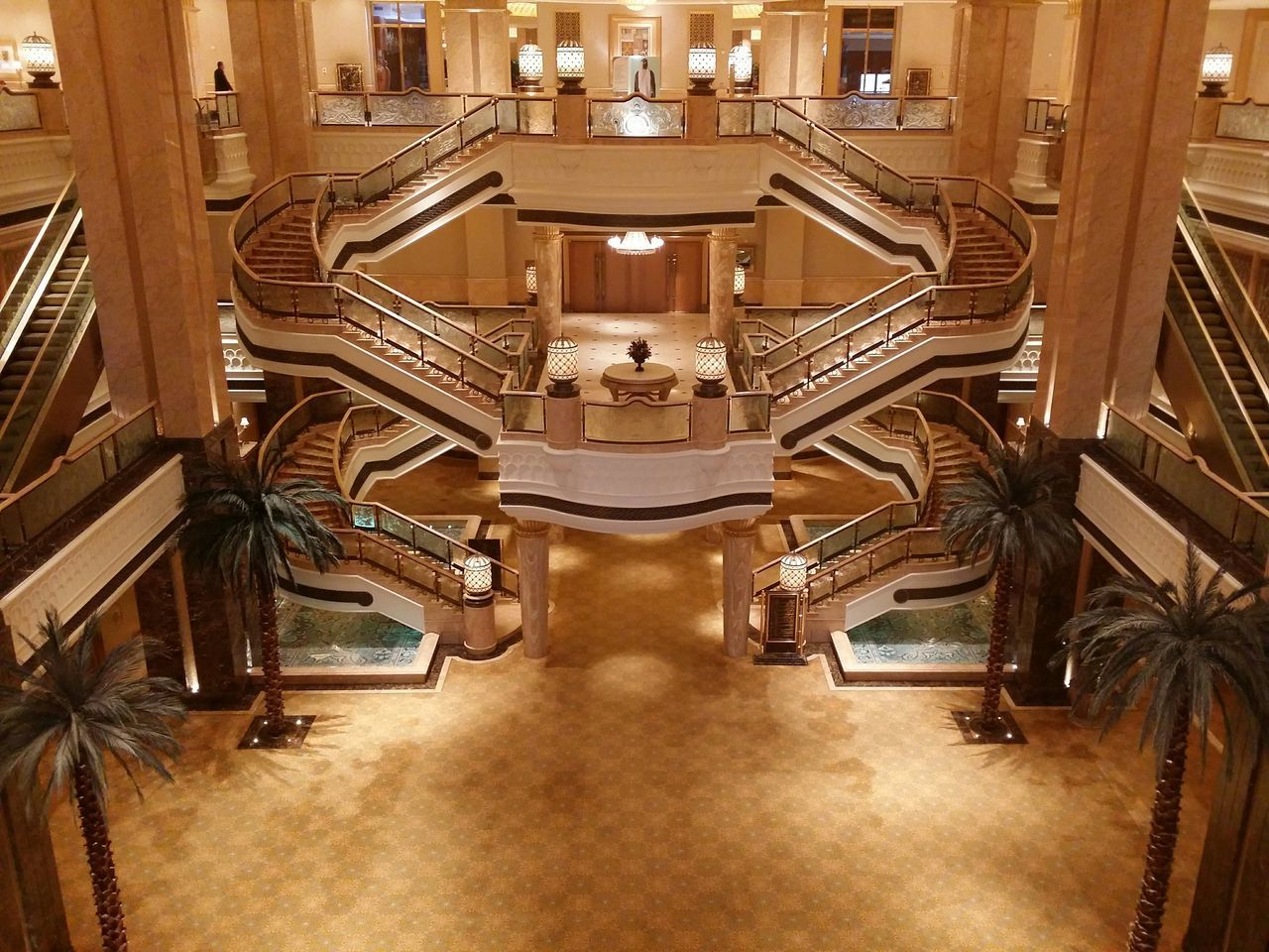 architecture, indoors, steps and staircases, built structure, chair, staircase, steps, symmetry, no people, illuminated, day