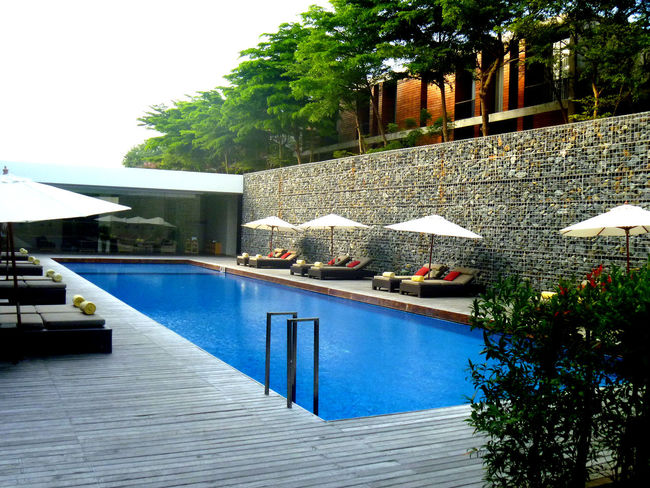 Architecture Beauty In Nature Blue Built Structure Day Design Growth Huahin Thailand Nature No People Outdoors Plant Resort Hotel Scenics Sky Swimming Pool Tranquil Scene Tranquility Travel Destinations Tree Vacations Water