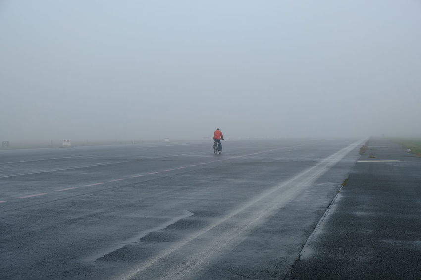 Berlin Berlin Tempelhof Berlin Tempelhof Airport Bicycle Trip Cyclist Driving Endless Tempelhofer Feld Traffic Cold Temperature Cycling Cycling Tour Cycling Around Empty Road Emty Street Fog Foggy Leisure Activity One Person Road Scenics Sport Tempelhof Airport Tempelhofer Freiheit The Way Forward Shades Of Winter An Eye For Travel Colour Your Horizn