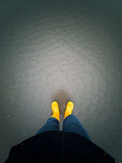 Low section of person standing on water