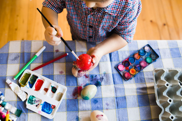 One Person Art And Craft Creativity Holding Child Multi Colored Indoors  Childhood Paintbrush Table Brush Leisure Activity Craft Casual Clothing Midsection Watercolor Paints Paint High Angle View Activity Palette Innocence Art And Craft Equipment